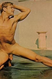 Naked muscle guy posing nude outside