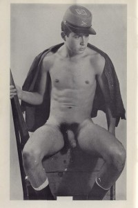 Naked muscle boy in vintage army uniform